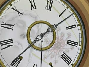 華麗なる時計と歪んだ顔
