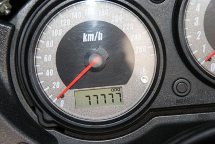 77,777km-1