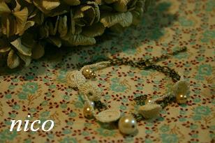 丸モチーフラリエットとパールの2連ブレス