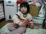ギターを弾くTomo