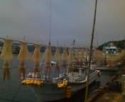 呼子の漁船とイカ干し