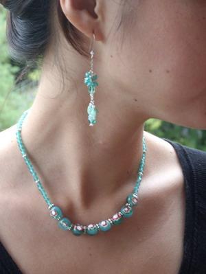 wearing example green necklace & dangle earrings